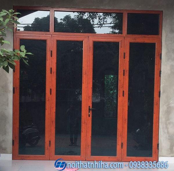 cửa nhôm kính 4 cánh vân gỗ cửa đi mặt tiền mở quay