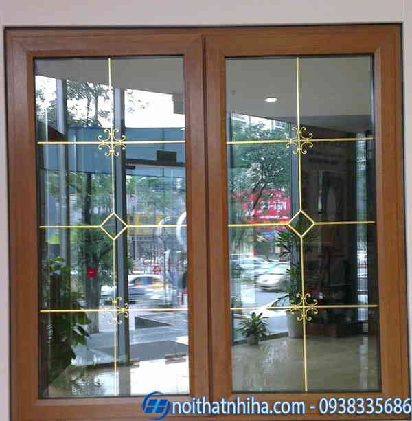 Cửa nhôm Xingfa vân gỗ kính hộp nan hoa đồng